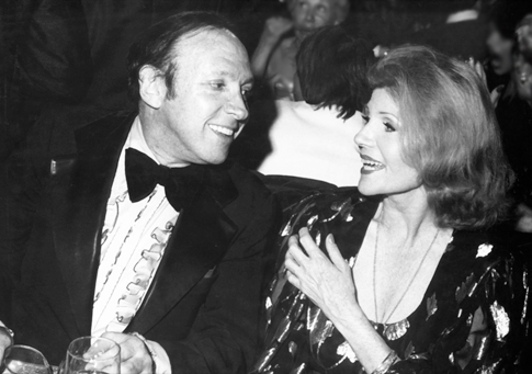 Marvin chatting with lovely Rita Hayworth