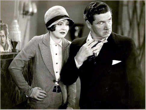 Nancy Carroll gets tough with a flustered George Bancroft.