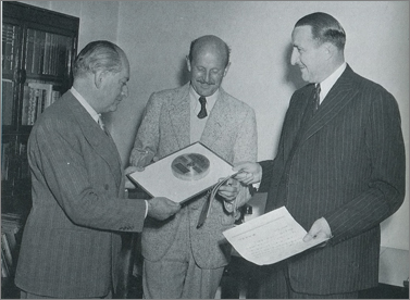 J. Arthur Rank presents Emeric Pressburger and Michael Powell with a Japanese award for 'The Red Shoes' (1948).