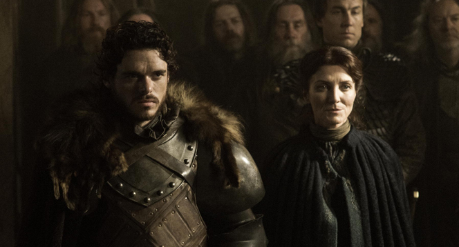 "Richard Madden and Michelle Fairly in ""The Rains of Castamere"""