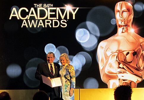 Like a high-school graduating class, names are called out alphabetically and each nominee accepts a handshake and certificate from Academy president Tom Sherak, in this case Glenn Close.