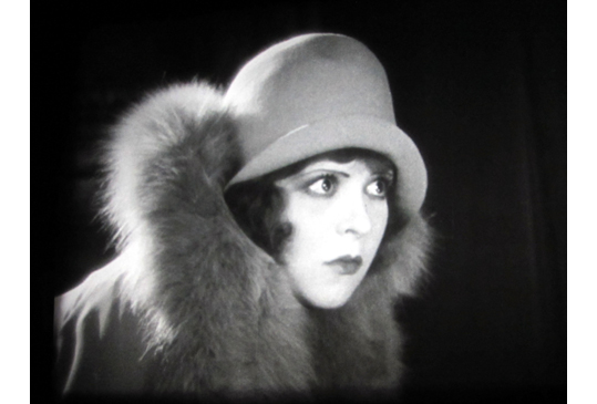 The irrepressible Clara Bow, photographed off the screen in 'Get Your Man'.