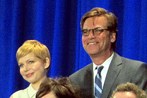 Another interesting pairing on the bleachers for the giant group photo: actress Michelle Williams and Moneyball screenwriter Aaron Sorkin.