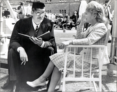 "Petula Clark visits her costar, Peter O'Toole (with ever-present cigarette) on location for ""Goodbye, Mr. Chips"" (1969), which earned the actor the fourth of his eight Academy Award nominations."