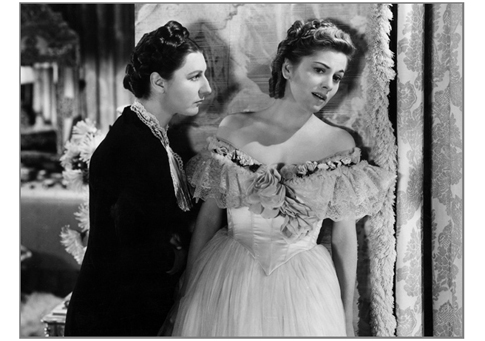 "Judith Anderson, as the sinister Mrs. Danvers, menaces Joan Fontaine in ""Rebecca"" (1940)"