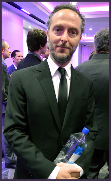 "Third-time LAFCA winner for Best Cinematography (this year for ""Gravity""), Emmanuel Lubezki poses with his prized bottle of water."