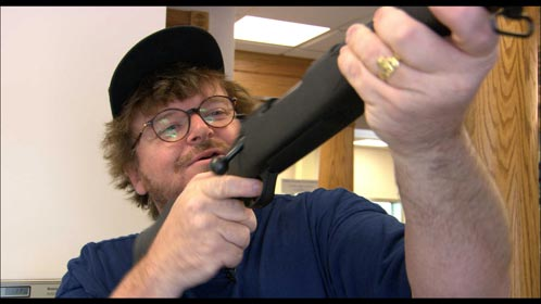 How does Michael Moore create change in the world? How does he get his points across effectively?