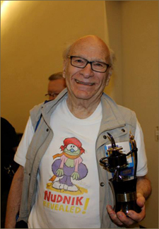 Gene Deitch happily poses with his Inkpot Award