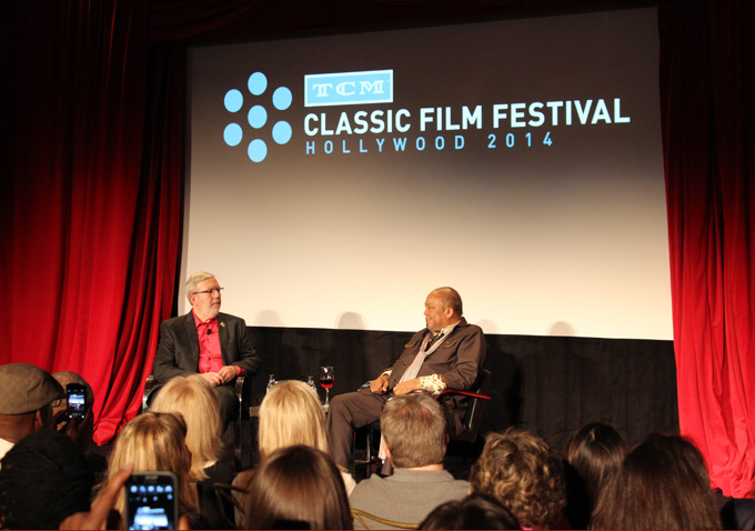 On stage, hands folded, with Quincy Jones at the TCM Classic Film Festival.