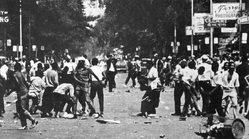 Crowds riot on July 23, 1967, in Detroit