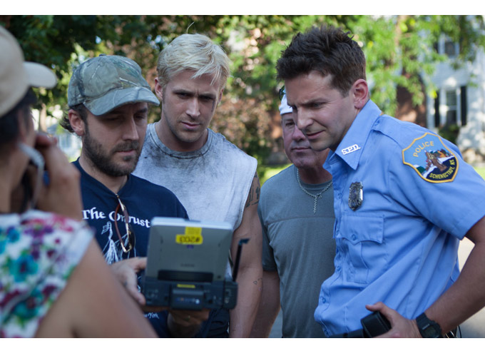 "Filmmaker Derek Cianfrance consults with his stars, Ryan Gosling and Bradley Cooper, while filming ""The Place Beyond the Pines"""
