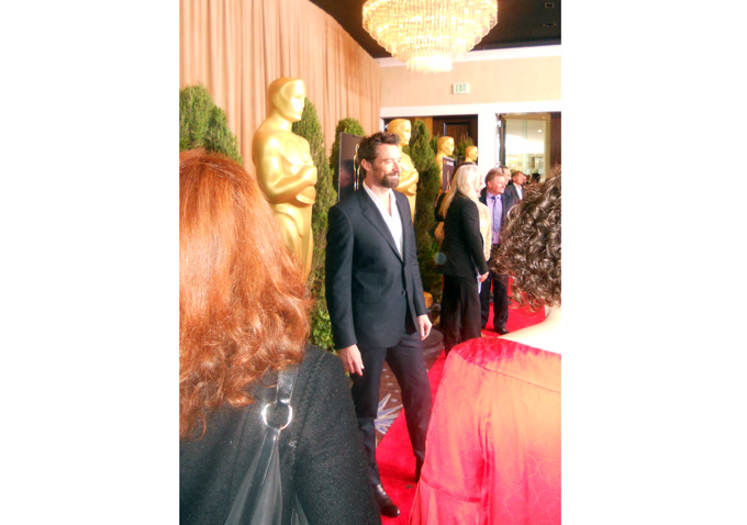 Hugh Jackman stops for photos before entering the luncheon.