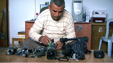 Co-director Emad Burnat and his five broken cameras
