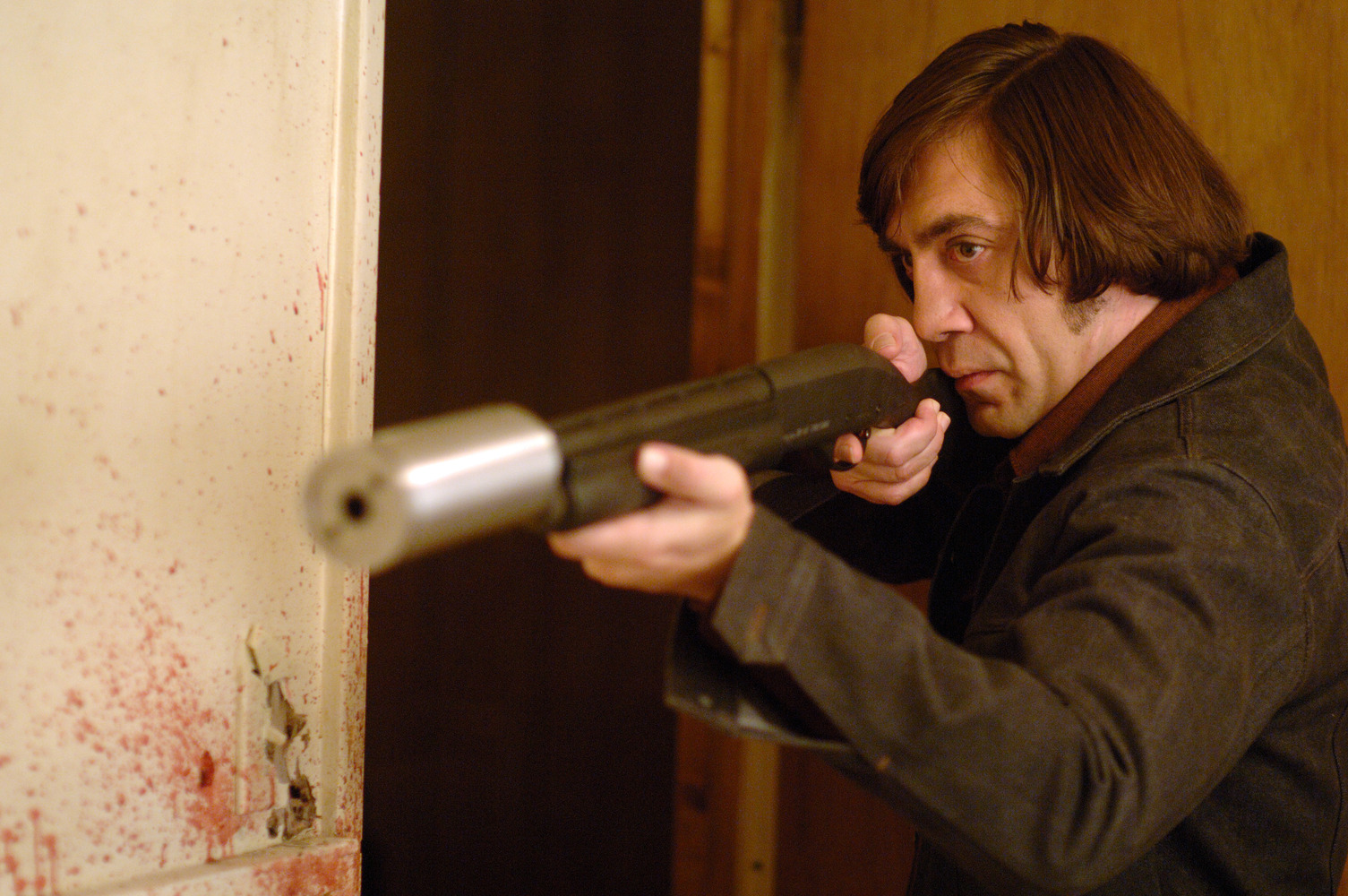 6 Most Badass Bounty Hunters in Film History No Country For Old Men Anton Chigurh Javier Bardem silenced shotgun RIPT Apparel