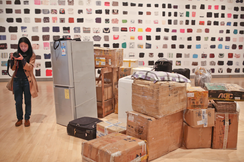 Nanfu Wang filming Ye Haiyan's belongings at the Brooklyn Museum