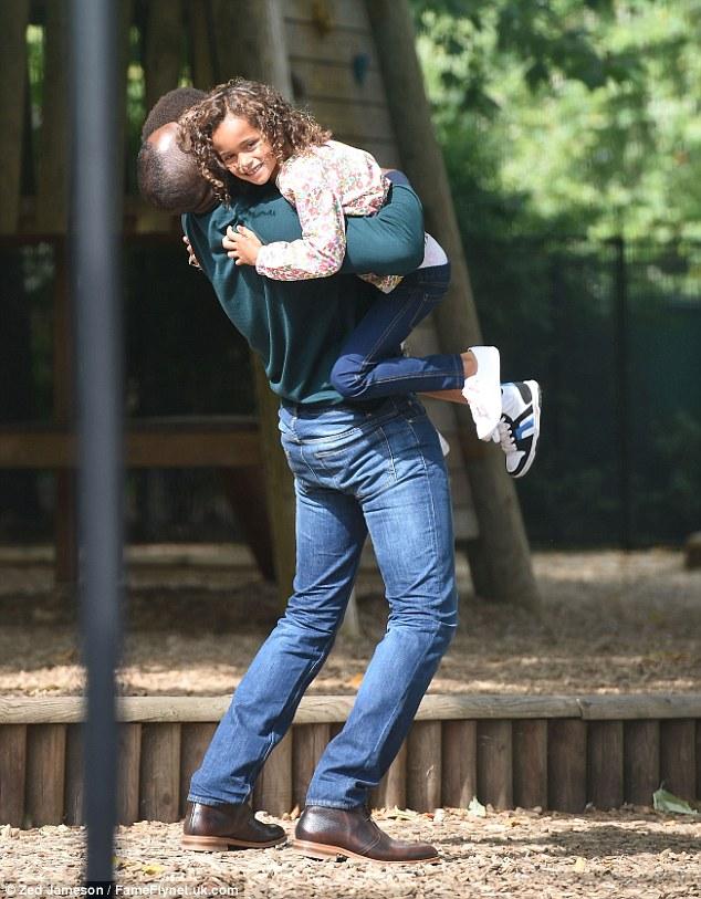 "Gemma Arterton with Idris Elba on the ""Hundred Streets"" set"