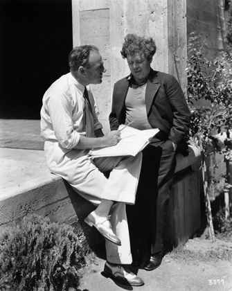 Tully confers with director Sam Wood during production of Way for a Sailor (1930) in which the author tried his hand at acting