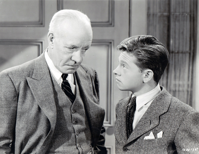 Mickey as Andy Hardy with his screen father, Lewis Stone.