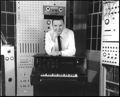 Raymond Scott poses with his Scott Clavivox, an early form of synthesizer.