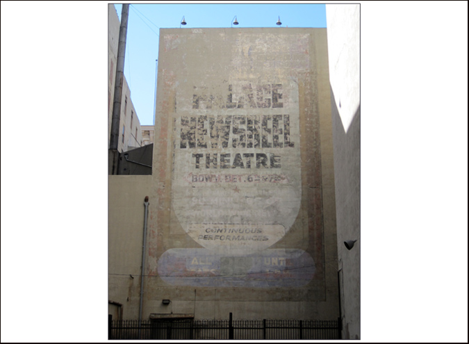 This faded signage still exists behind the Palace Theatre on Broadway in Los Angeles, heralding a period when the majestic cinema became a newsreel emporium