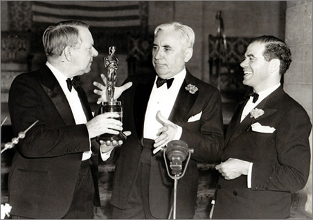 Sennett hams it up with two of his more illustrious alumni, W.C. Fields and Frank Capra, upon receiving an honorary Oscar in 1938.