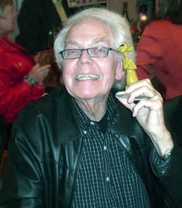 Stan Freberg holding Looney Tunes Pete Puma