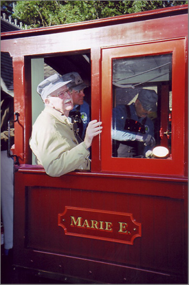 Lifelong railroad buff Ollie Johnston aboard his beloved Marie E. locomotive on its last run, around the perimeter of Disneyland, in 2005.