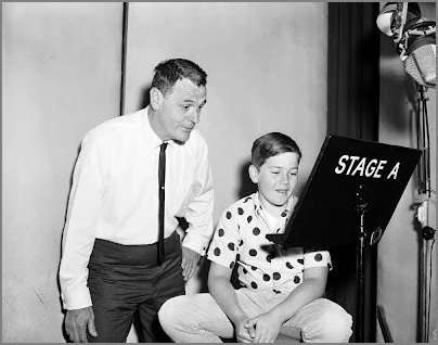 "In this clearly posed shot, Wolfgang Reitherman coaches his son Bruce during a recording session for ""The Jungle Book"""