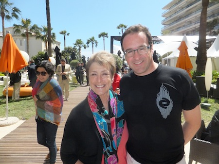 Sydney Levine and CineCoup's Brad Pelman meet and greet on the busy lawn and deck of Cannes' Grand Hotel