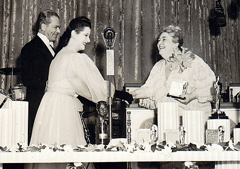 Celebrated stage actress Lynn Fontanne presents the Best Supporting Actress award to Jane Darwell for 'The Grapes of Wrath', as Academy president Walter Wanger looks on, in 1941. The microphone sleeve, which is hard to read, says BILTMORE, so it was primarily used to amplify sound within the hotel ballroom.