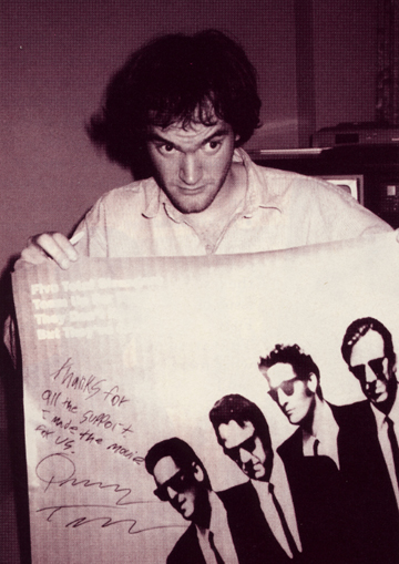 "Tarantino in Toronto with his ""Reservoir Dogs"" poster, in 1992."