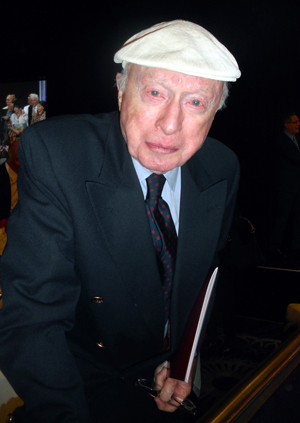Dapper as ever, nonagenarian Norman Lloyd sports Jean Renoir's cap, which the director bequeathed to him.