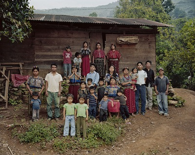 The Caba family in front of their home in Ixil highlands of Guatemala. The army massacred 95 people in their village in 1982 during the genocide.