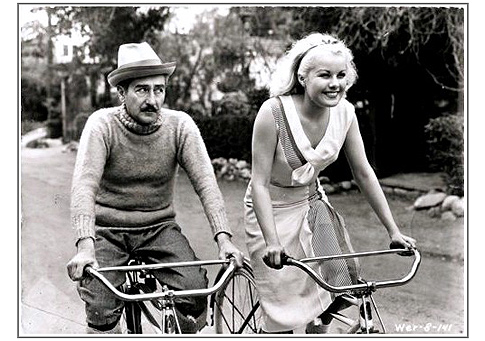 "Adolphe Menjou and sexy Joan Marsh in ""Bachelor's Affairs."""