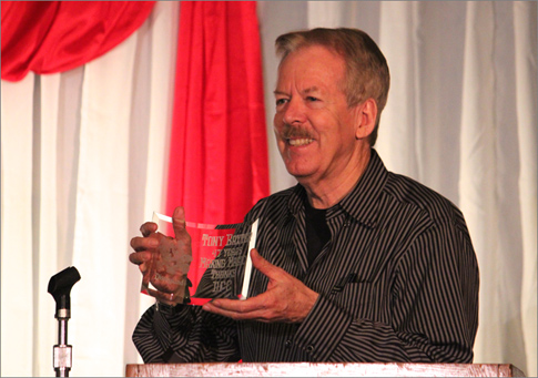 Longtime Imagineer Tony Baxter holds his award from the Disneyana Fan Club.