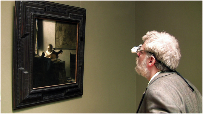"Jenison inspects Johannes Vermeer's ""Woman with a Lute"" at the Metropolitan Museum of Art in New York."