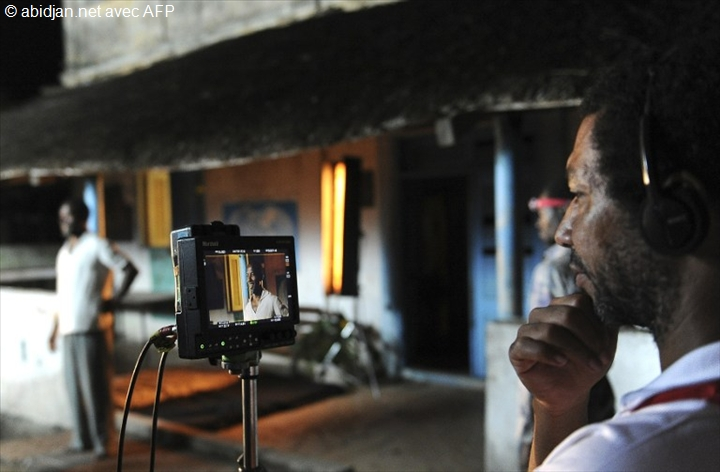 "Director Philippe Lacote (R) and actor Isaach de Bankole shoot a scene in the film ""Run"" in Bassam on August 18, 2013."